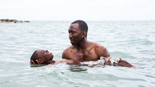 Alex Hibbert and Mahershala Ali star in 'Moonlight.'