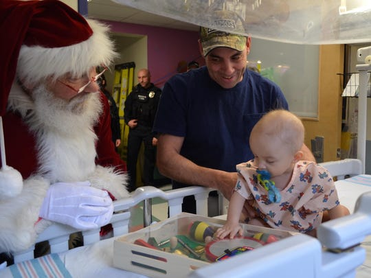 Ryland Houle of Middlebury is pictured with dad and Santa Claus.