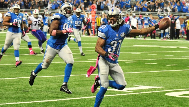 Lions' Rashean Mathis will be busy trying to keep Patriots tight end Rob Gronkowski in front of him.