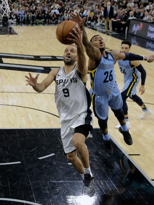 San Antonio Spurs guard Tony Parker (9) scores past Memphis Grizzlies Xavier Rathan-Mayes (26) during the second half of an NBA basketball game, Monday, March 5, 2018, in San Antonio. (AP Photo/Eric Gay)