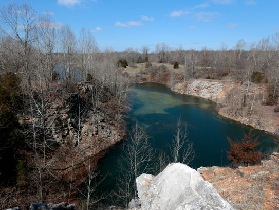 A water filled quarry on her property offers a water