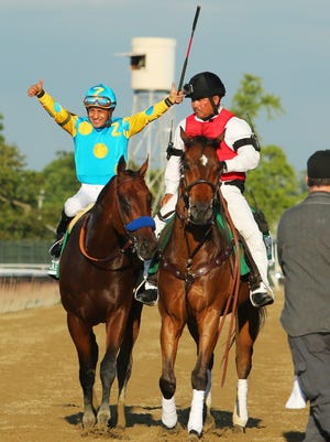 Victor Espinoza aboard American Pharoah celebrates after winning the 2015 Belmont Stakes and the Triple Crown at Belmont Park.
