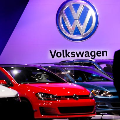 A man looks at the Volkswagen display at the 2016 New