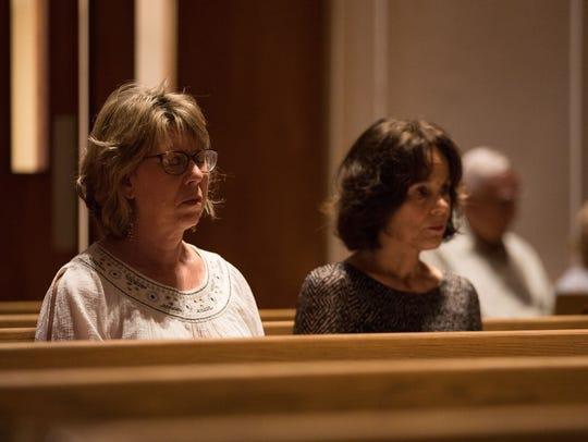Debbie Dunham and Sue Barley attend a prayer vigil
