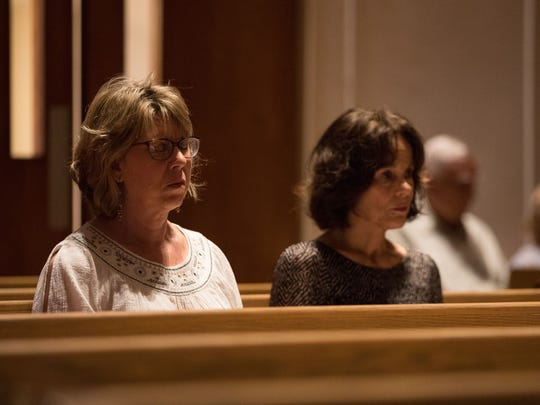 Debbie Dunham and Sue Barley attend a prayer vigil at All Saints' Episcopal Church on Thursday, June 21, 2018. The vigil focused on migration issues in-light of recent events on the border.