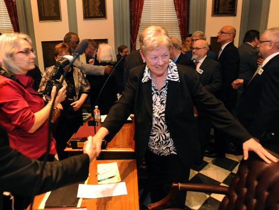 Sen. Karen Peterson, D-Stanton, shakes hands after the state Senate passed legislation allowing same-sex marriage on May 7, 2013.