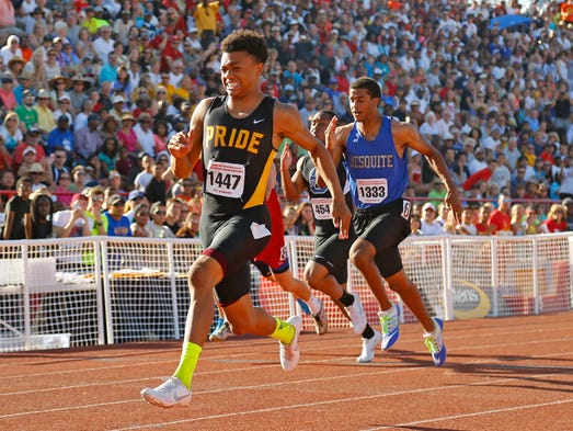Mountain Pointe's Paul Lucas takes the Division I 100 meter dash with a time of 10.66 during the state track and field championships at Mesa Community College Saturday, May 10, 2014 in Mesa, Arizona.