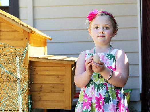 Anna, 5, found an egg in the chicken coop. Jimmy and Whitney Dineen have two young daughters and moved a couple years ago into her parents' home in north Albany, and they're learning to live a sustainable life. The goal is to find a 10-acre spread where they can really live off the land. Whitney is an author of a book and a blog. She also has a baking business that still serves big names in Hollywood.