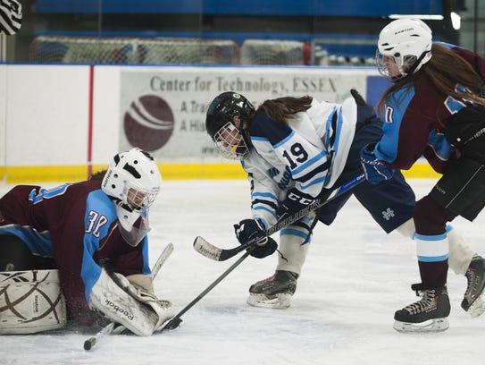 North Country goalie Mikaella Doran (30) makes a save
