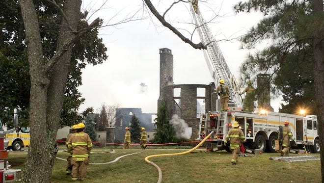 After an early morning fire Jan. 19, 2015, in Annapolis, Md., only some stonework remains standing of a seven-bedroom, seven-and-a-half bathroom waterfront mansion.