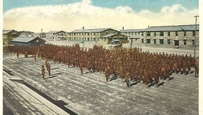 This postcard shows a troop review at Camp Sherman during World War I.