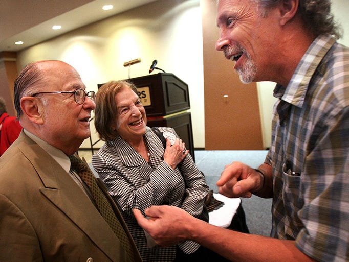 Israeli sculptor-artist Rick Wienecke, right, visits with Romania Holocaust survivors Leonid and wife Friderica Saharovici before a benefit breakfast, Monday, June 9, 2014, in Hernando, Miss. The Unknown Child Foundation is raising funds to complete a remembrance park in Hernando.