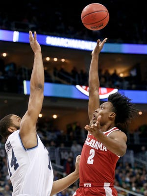 Alabama's Collin Sexton (2) floats a shot over Villanova's Omari Spellman (14) during the first half of a second-round game in the NCAA men's college basketball tournament, Saturday, March 17, 2018, in Pittsburgh. (AP Photo/Keith Srakocic)