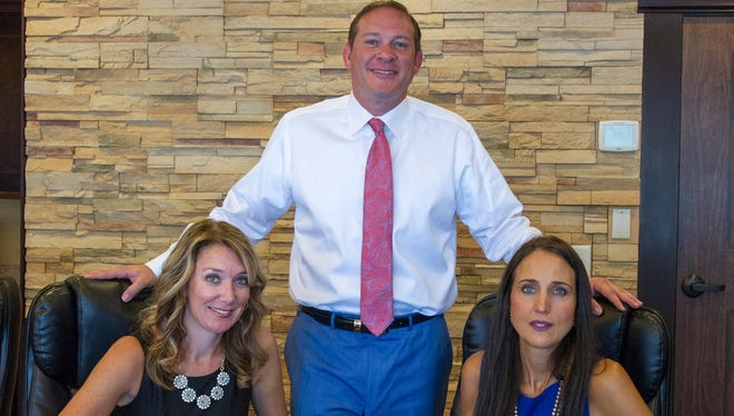 Premium Mortgage CEO and President Mike Donoghue of Rochester, with CFO Gwen Falbo of Spencerport, left, and Vice President Alexia Barbarossa of Penfield at their offices in Brighton.