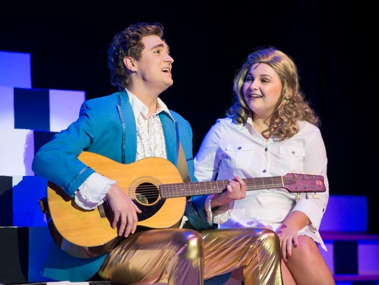 "Justin Gaylard as Robbie Hart, left, and Kendall Parrett as Julia Sullivan perform during rehearsal of ""The Wedding Singer"" musical at the Pensacola Little Theatre in Pensacola on Tuesday, October 31, 2017. Performances continue through Nov. 12."
