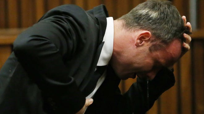 Oscar Pistorius weeps as he listens to evidence by a pathologist in court in Pretoria, South Africa, on April 7.