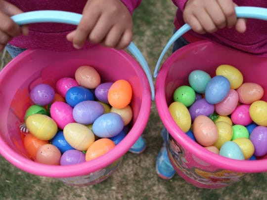 Sisters hold their buckets filled with Easter eggs at last year's Easter Fest. Find out more about this year's celebration on Page 16. Michelle Gaitan/Standard-Times