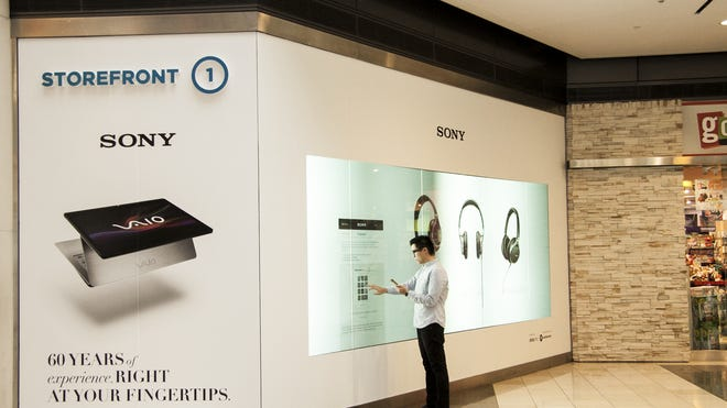 "EBay's ""connected glass"" technology sells Sony gadgets at the Westfield shopping mall in San Francisco in late 2013."