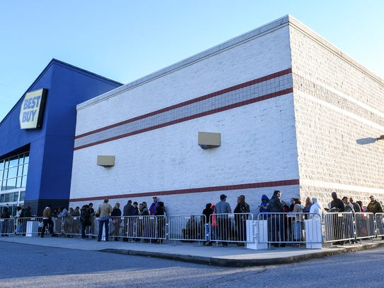Black Friday shoppers line up for the opening of Best