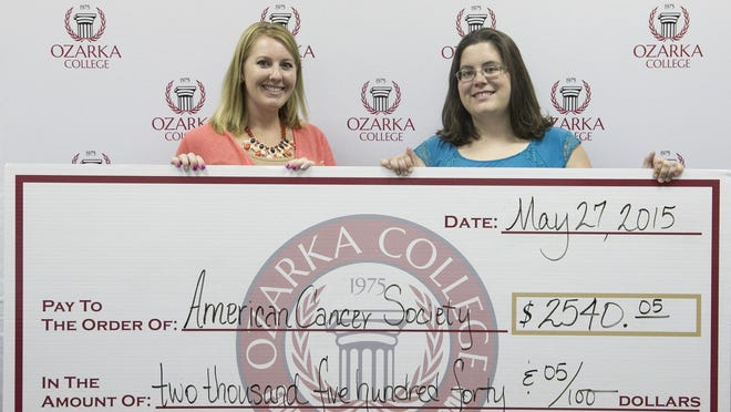 Manda Jackson, left, of Ozarka College presents $2,540.05 to Whitney Rodgers, American Cancer Society Community representative. The donation is the proceeds of the Grillin' for a Cure and Silent Auction events, which Jackson chaired. The Izard County Relay for Life is set for 7 p.m. Friday at Izard County Fairgrounds in Melbourne.