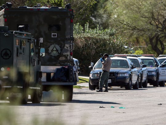 Police continue their investigation of the killing of Palm Springs police officers Lesley Zerebny and Jose Gil Vega on the 2700 block of Cypress Road in Palm Springs. Photo taken on Sunday, October 9, 2016.