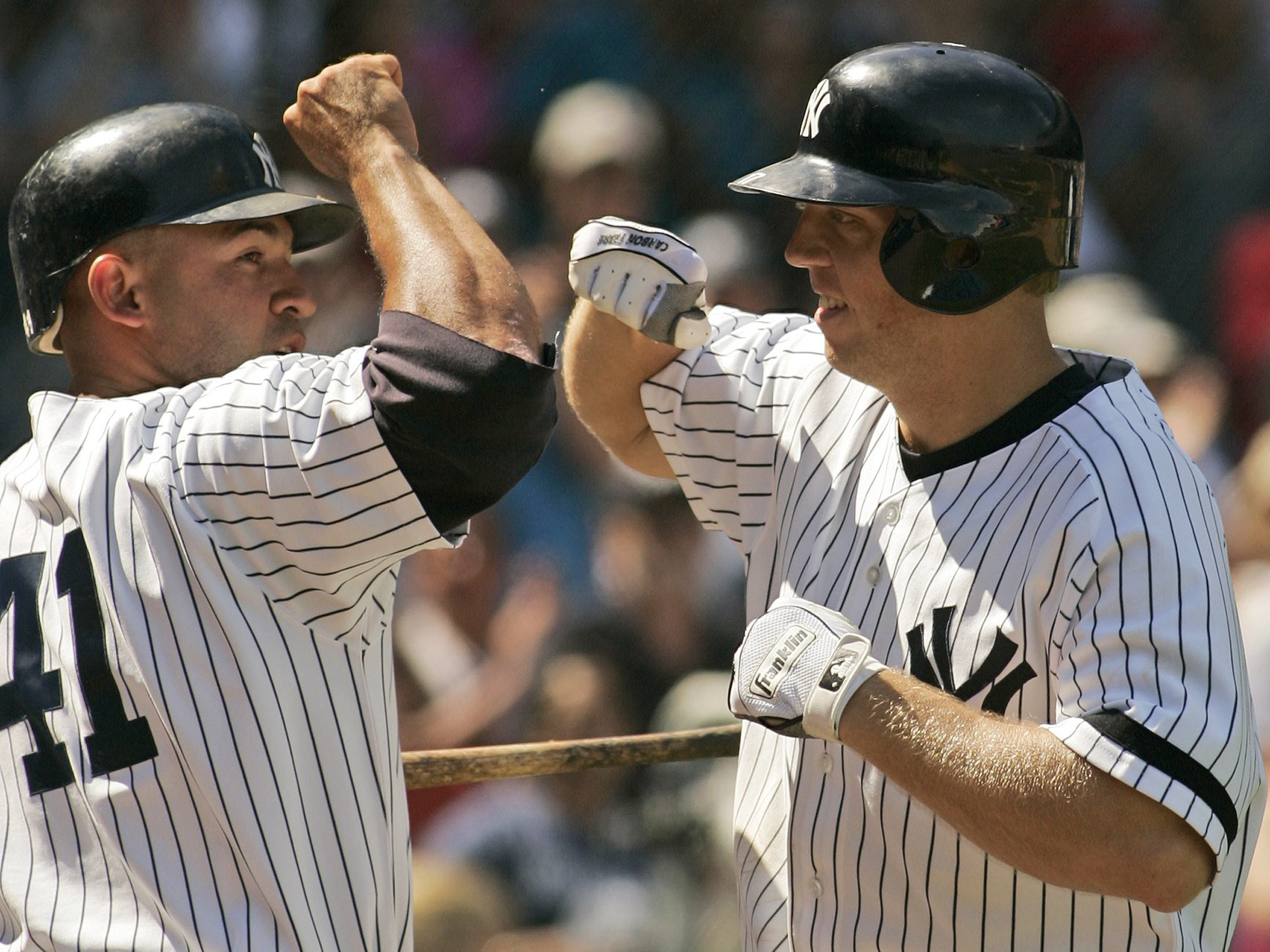 In 2007, New York Yankees Shelley Duncan is congratulated by Miguel Cairo after hitting a solo home run at Yankee Stadium in New York.