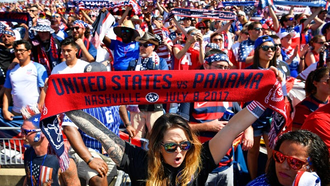 Haley Cooper holds up a scarf with today's game and date as she joined with other American Outlaws who got excited before US met Panama in the Concacaf Gold Cup at Nissan Stadium. Saturday July 8, 2017, in Nashville, TN