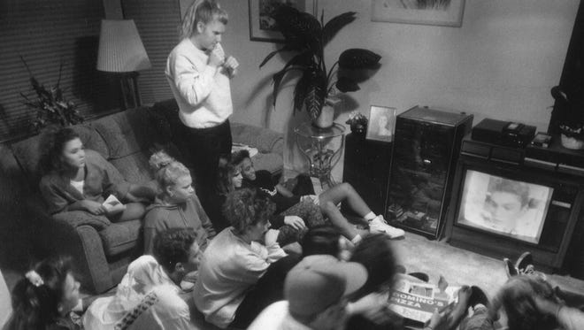 "Here's the caption from this November 1991 RGJ photo: ""More than 20 Reed High School students met at Michelle Cunning's house to watch Thursday night's episode of 'Beverly Hills 90210,' about which there were rumors of a death."""