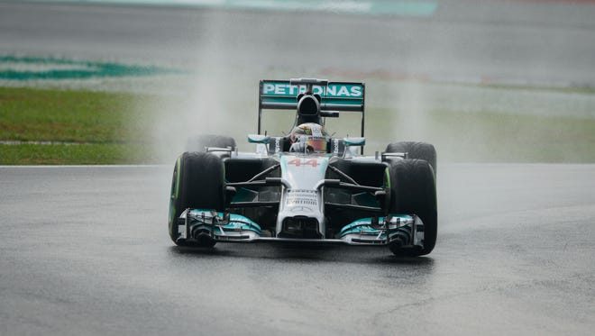 Mercedes driver Lewis Hamilton of Britain takes a corner during the first qualifying session of the Formula One Malaysian Grand Prix.