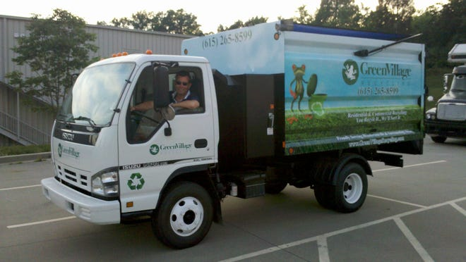 A Green Village Recycling truck services customers in Springfield.