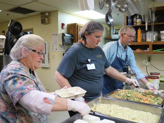 Members of the Good Samaritan Society on Wednesday prepare frozen meals to be delivered to patrons of the Van Matre Senior Center's Meals on Wheels program.