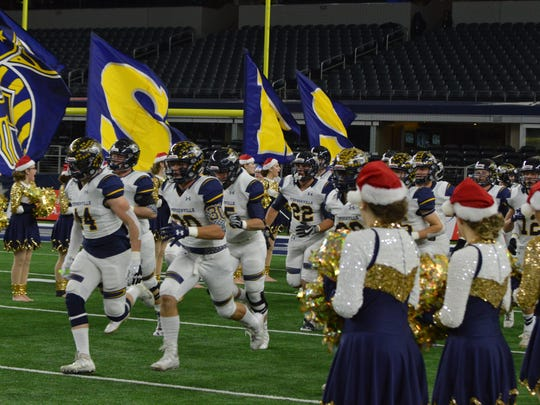 Stephenville enters the field prior to Kennedale's 54-28 win over SHS in a Class 4A DI state semifinal at AT&T Stadium in Arlington on Fri., Dec. 15, 2017.