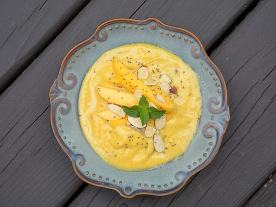 Turmeric adds extra-healthful properties to this mango lassi smoothie bowl.