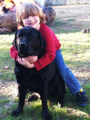 "Columnist Campbell Vaughn's son, Win, loves on Bucket, a dog whose ""life's mission was to just be near you,"" he writes."