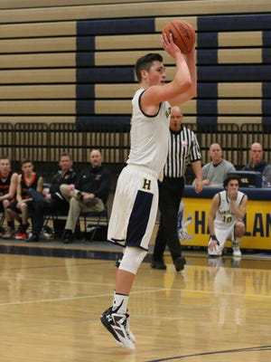 Hartland's Konlan Paul scored a game-high 19 points to lead the Eagles to an upset of Howell in the Lakes Conference semifinals of the KLAA Boys Basketball Tournament.
