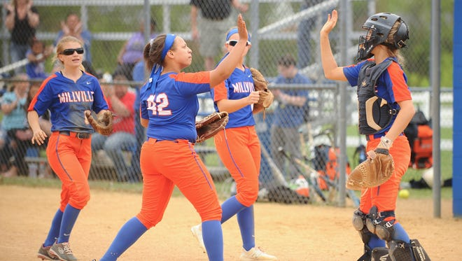 Millville's softball team celebrates after beating Delsea 2-1 in the Hammonton Invitational Tournament championship game on Saturday.