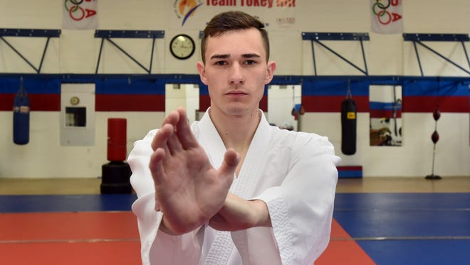 Austin Pfeifer recently won a karate national championship for fighting.