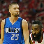 James Harden #13 of the Houston Rockets battles for a rebound with Rajon Rondo #9 of the Dallas Mavericks during Game One in the Western Conference Quarterfinals of the 2015 NBA Playoffs on April 18, 2015 at the Toyota Center in Houston, Texas.