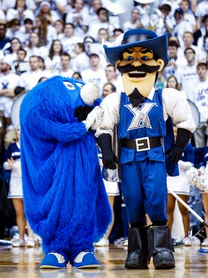 The Blue Blob and D'Artagnan cheer during a timeout of the Xavier-Villanova.  Xavier adopted its Musketeers nickname in 1925.