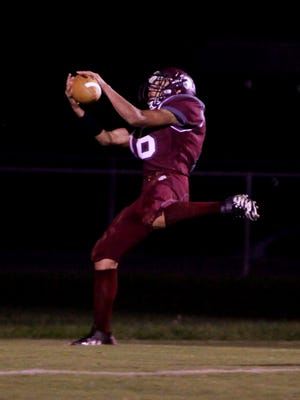 Stuarts Draft's Xzavier Gunn catches a touchdown pass during the first half of the game against Buffalo Gap in Stuarts Draft on Monday, Oct. 10, 2016, which was rescheduled due to rain last Friday.