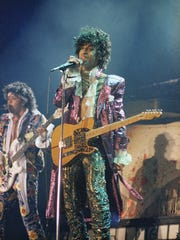Singer Prince performs in concert in 1985 with The