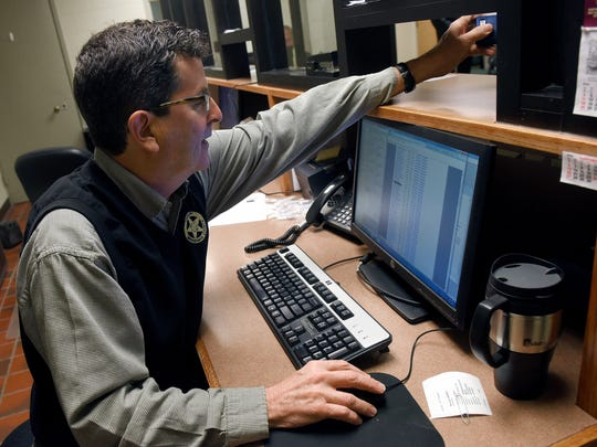 Jon Hagen, a correctional officer for Minnehaha County, administers a Breathalyzer test for offenders in the wing of the Minnehaha County jail dedicated to the 24/7 Sobriety Program in Sioux Falls, S.D., on Thursday, Dec. 1, 2016.