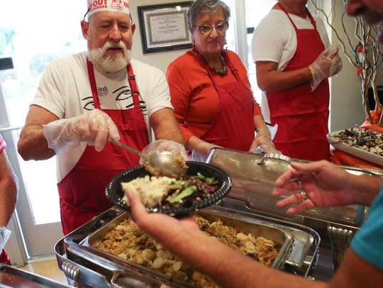 Volunteers serve a Thanksgiving meal at the Desert