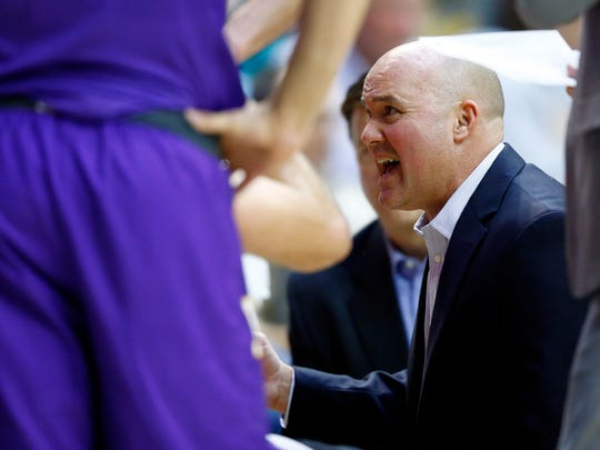 Lipscomb head coach Casey Alexander instructs his players during their game against Belmont on Nov. 27, 2017, in Nashville.