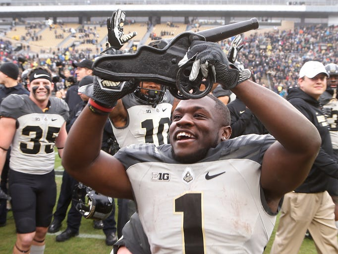 D.J. Knox celebrates with the Canon traveling trophy