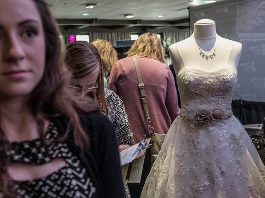 The Lansing Bridal Show was crowded with people checking out dozens of vendors at the University Club of MSU on Saturday.