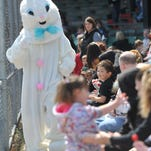 Kids gather eggs at McBride Stadium for the Richmond Park and Recreation Department's egg hunt on March 30, 2013.