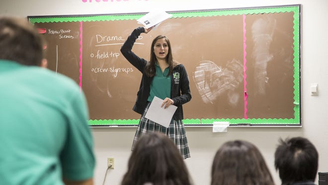 St. Mary's Catholic High School student Ella Sullivan talks to students during a drama class on Tuesday, Oct. 27, 2015. Sullivan is part of a multi-generation St. Mary's family.