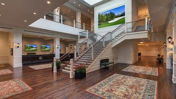 The grand staircase welcomes press into the new Press Building at Augusta National Golf Club. The new facility boasts a state of the art Working Arena and Interview Room, expanded suites for television, radio and photographers, new gentlemen and ladies locker rooms and a full-service restaurant.