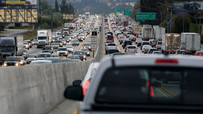 Traffic crawls May 22, 2015, along the 60 Freeway during rush hour in Rowland Heights, Calif.